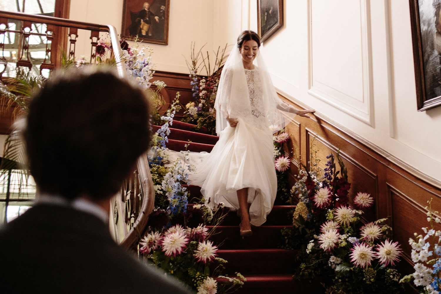 Bride walking down the stairs at a Dutch Wedding